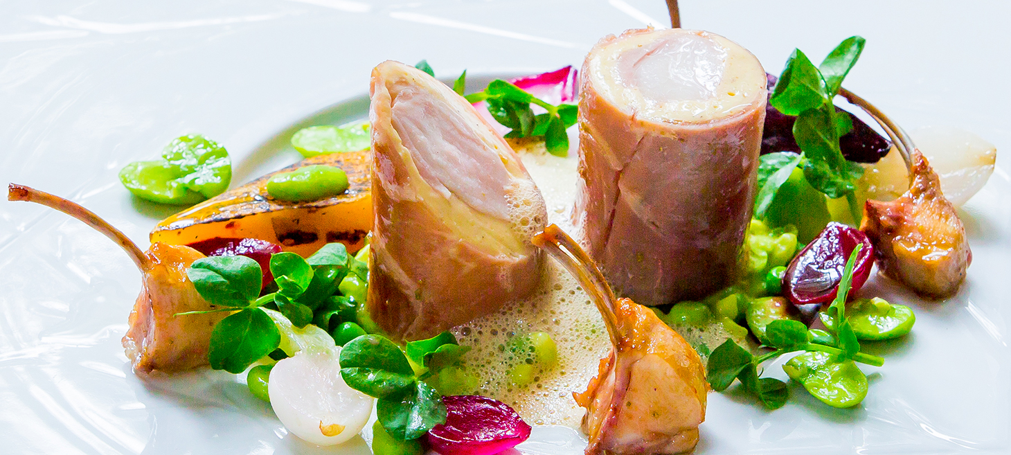 Loin of Rabbit wrapped in parma ham with pea mint risotto