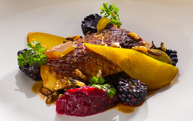 Pan fried duck liver with pickled pear blackberries and ginger